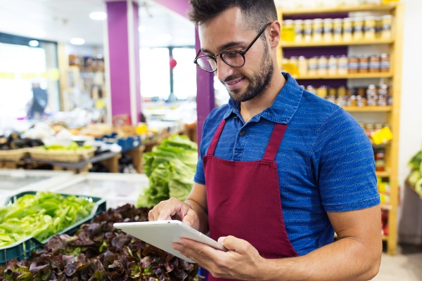 Man with tablet in grocery store-1